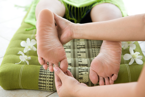 http://www.dreamstime.com/royalty-free-stock-photos-masseur-giving-female-patient-foot-reflexology-image4696208